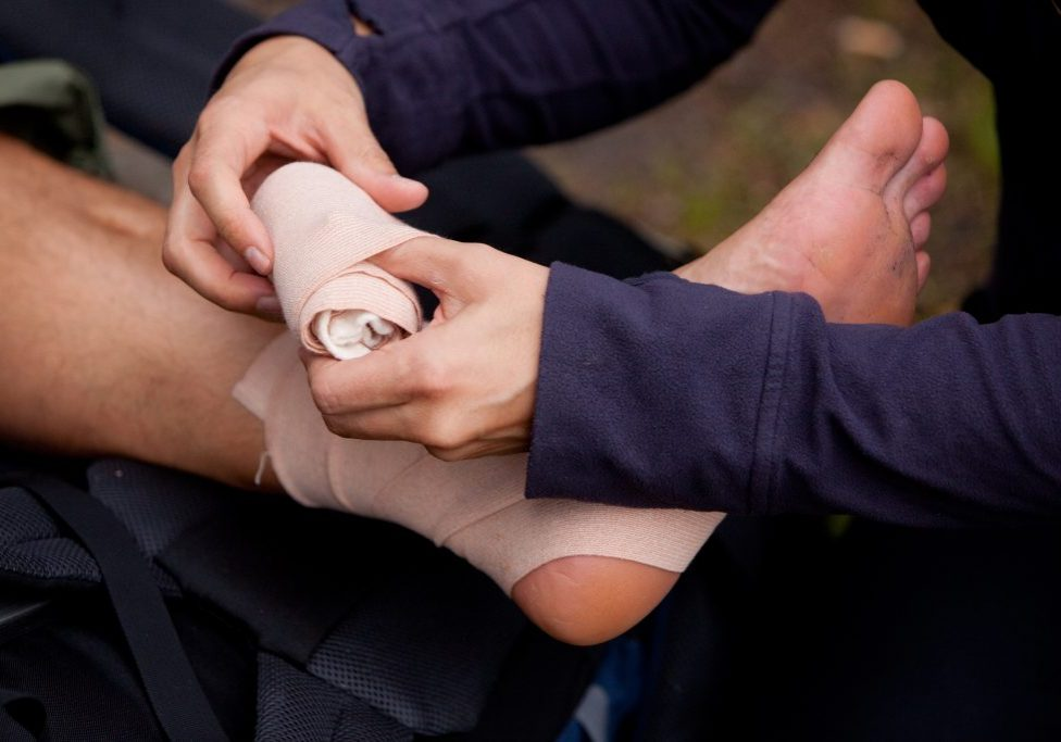 A leg tensor bandage being applied outdoors